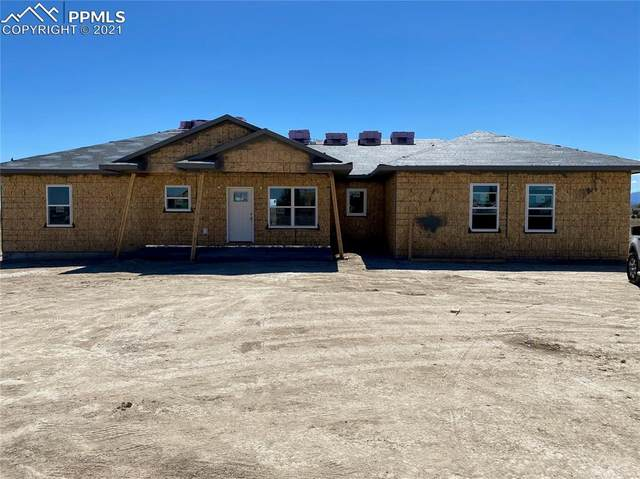 1080 W Mcculloch Boulevard, Pueblo West, CO 81007 (#8844499) :: The Artisan Group at Keller Williams Premier Realty