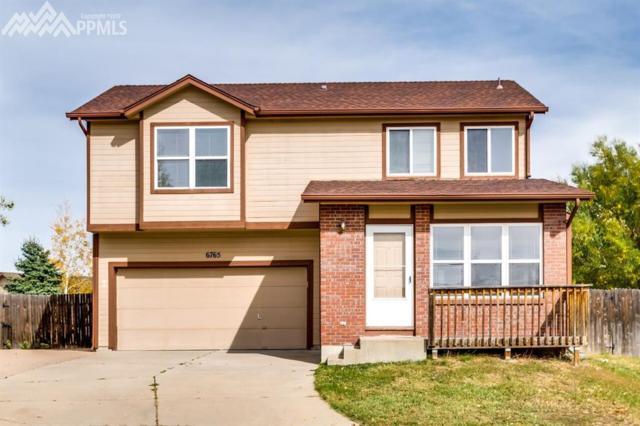 6765 Bear Tooth Drive, Colorado Springs, CO 80923 (#8845882) :: Jason Daniels & Associates at RE/MAX Millennium