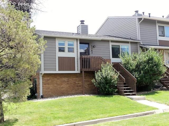 5567 Dunbar Court, Colorado Springs, CO 80918 (#8936556) :: Symbio Denver