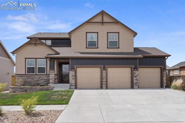 6772 Indian Feather Drive, Colorado Springs, CO 80923 (#8955346) :: The Hunstiger Team