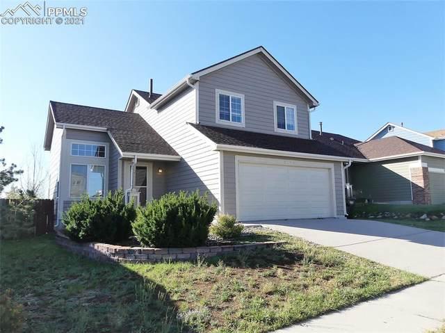 5143 Prairie Grass Drive, Colorado Springs, CO 80923 (#8967157) :: Symbio Denver