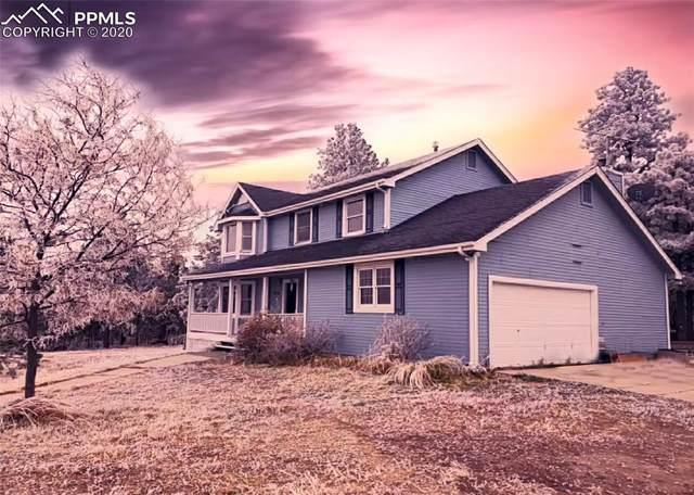 9735 Walker Road, Colorado Springs, CO 80908 (#8984325) :: HomeSmart