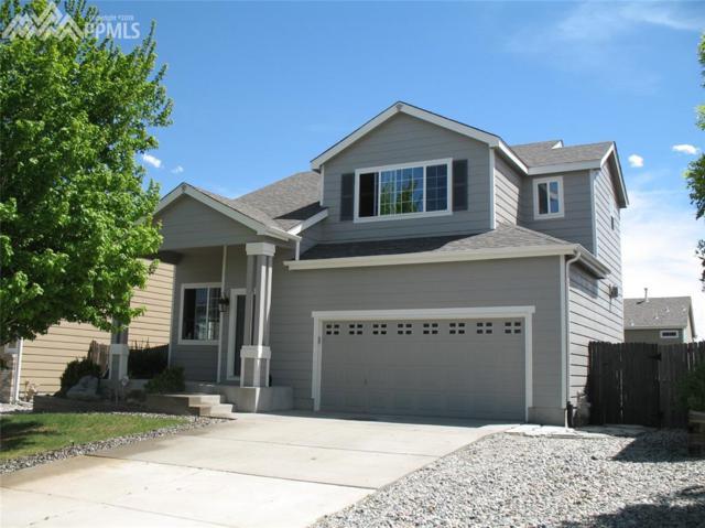 4521 Crow Creek Drive, Colorado Springs, CO 80922 (#9030005) :: The Peak Properties Group
