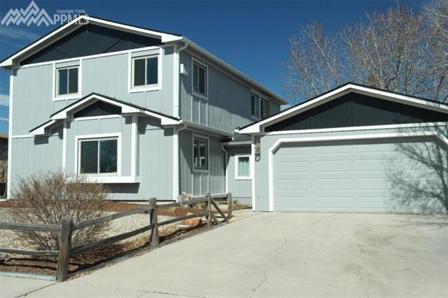 2440 Piros Drive, Colorado Springs, CO 80915 (#9137579) :: The Hunstiger Team