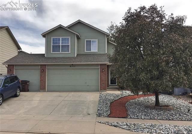 6711 Wagon Ridge Drive, Colorado Springs, CO 80923 (#9171086) :: The Peak Properties Group