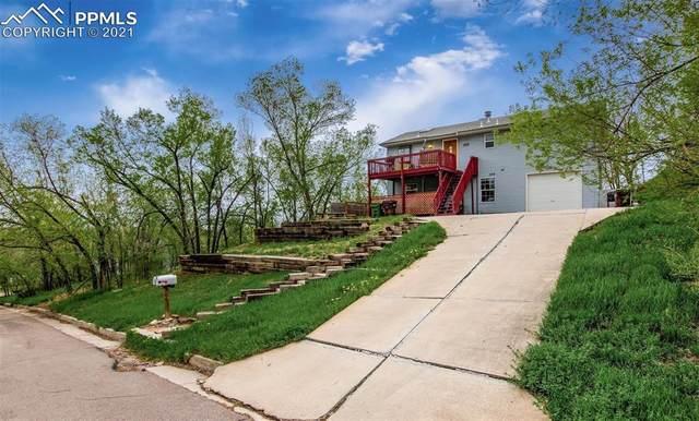 555 - 559 W Monument Street, Colorado Springs, CO 80905 (#9229275) :: HomeSmart