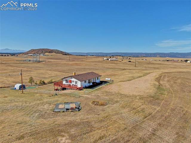 4531 Best Road, Larkspur, CO 80118 (#9550319) :: Tommy Daly Home Team