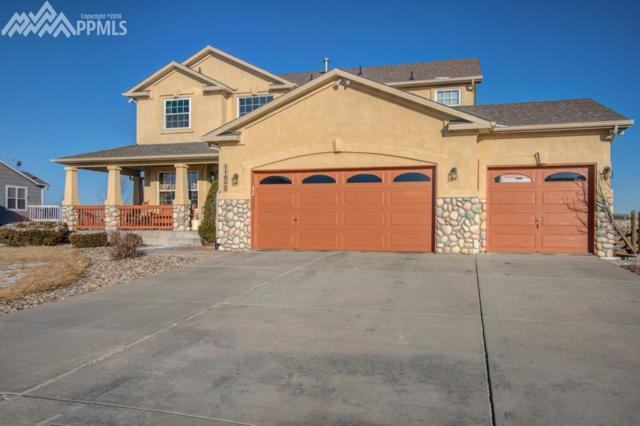 11662 Rio Secco Road, Peyton, CO 80831 (#9564856) :: The Hunstiger Team