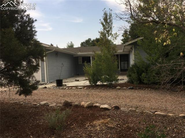 2945 W Montebello Drive, Colorado Springs, CO 80918 (#9581458) :: The Hunstiger Team