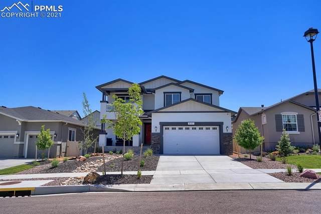 8137 Gilpin Peak Drive, Colorado Springs, CO 80924 (#9624326) :: HomeSmart