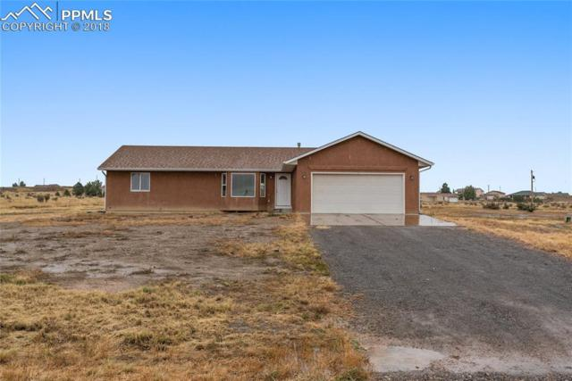 1128 N Calico Rock Lane, Pueblo West, CO 81007 (#9634619) :: The Hunstiger Team