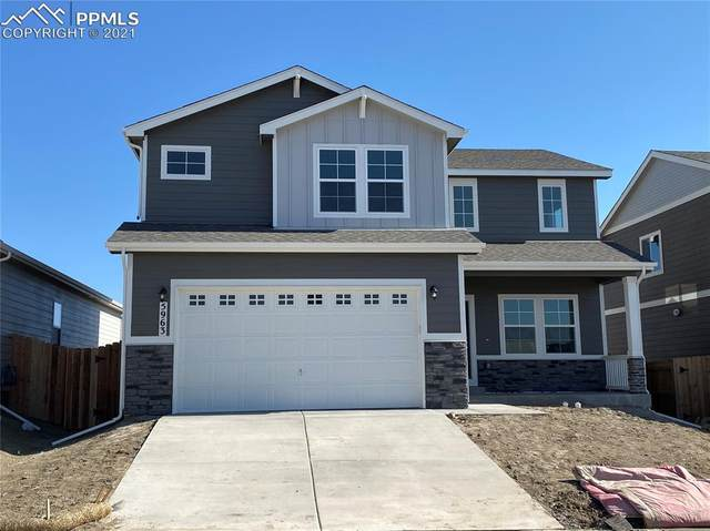 5963 Mumford Drive, Colorado Springs, CO 80925 (#9642726) :: Fisk Team, RE/MAX Properties, Inc.