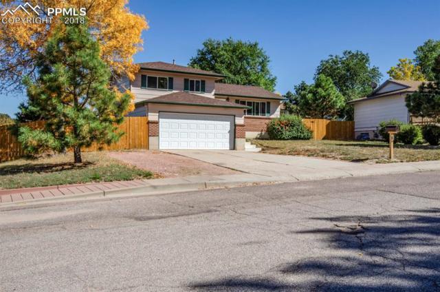 5789 Tuckerman Lane, Colorado Springs, CO 80918 (#9676817) :: The Hunstiger Team