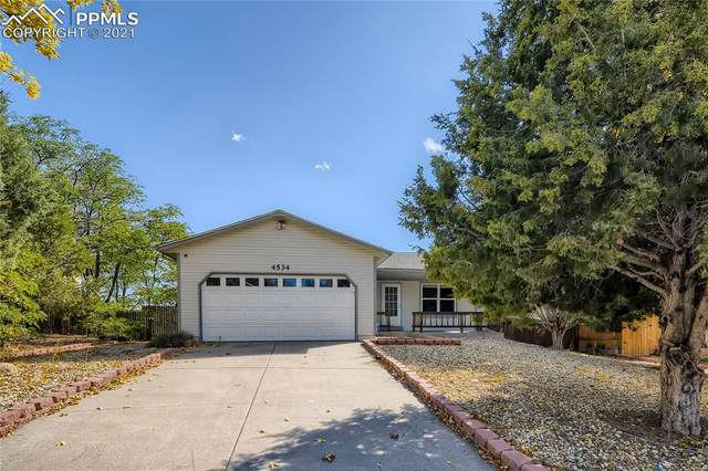 4534 Harwood Road, Colorado Springs, CO 80916 (#9677622) :: The Gold Medal Team with RE/MAX Properties, Inc