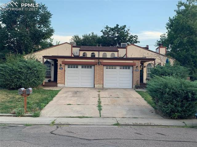 9348 W 56th Place, Arvada, CO 80002 (#9731325) :: HomeSmart