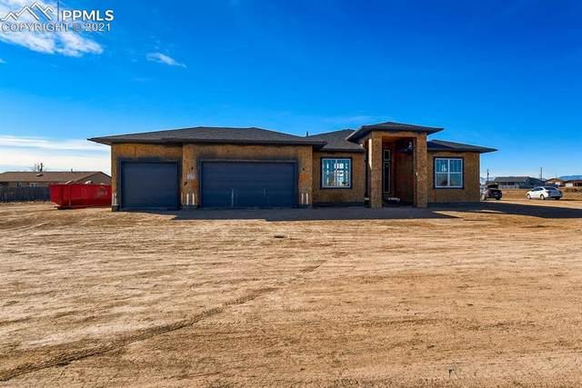 1212 E Platteville Boulevard, Pueblo West, CO 81007 (#9735043) :: Compass Colorado Realty