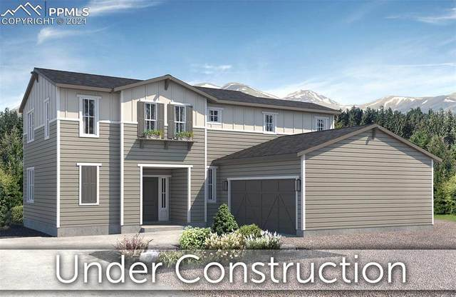 5813 Spring Breeze Drive, Colorado Springs, CO 80923 (#9775185) :: Tommy Daly Home Team