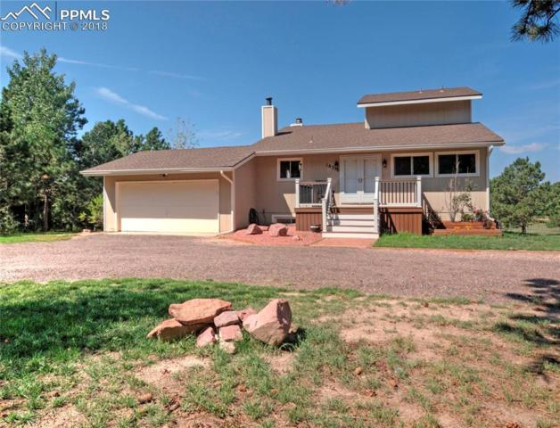 18350 Woodhaven Drive, Colorado Springs, CO 80908 (#9915545) :: Action Team Realty