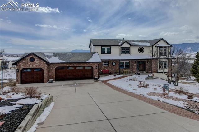 575 Harness Road, Monument, CO 80132 (#1027555) :: The Hunstiger Team