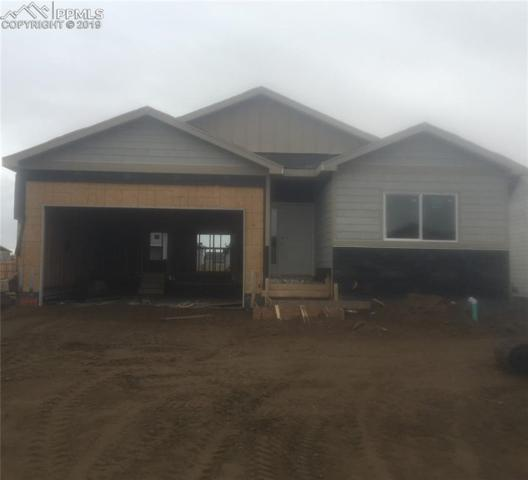 6849 Simcoe Drive, Colorado Springs, CO 80925 (#1591223) :: The Hunstiger Team