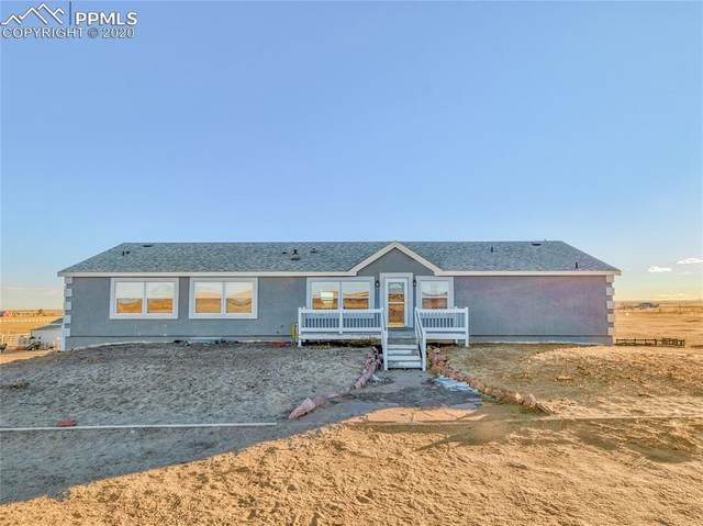 20430 Cheryl Grove, Peyton, CO 80831 (#1928611) :: The Kibler Group