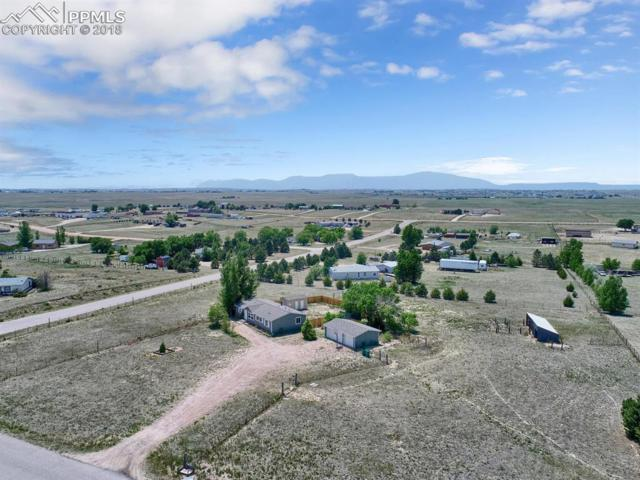 6110 Prospero Road, Peyton, CO 80831 (#2078275) :: The Hunstiger Team