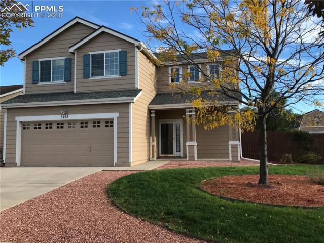 5165 Mountain Air Circle, Colorado Springs, CO 80916 (#2228579) :: Jason Daniels & Associates at RE/MAX Millennium