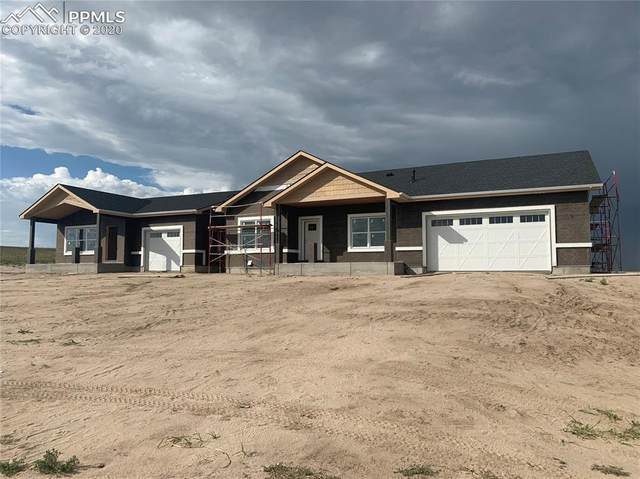 7831 Buckskin Ranch View, Peyton, CO 80831 (#2277591) :: The Dixon Group