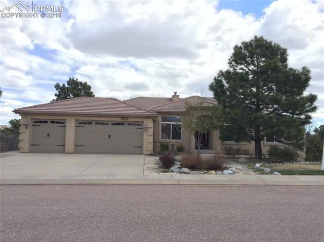 4595 Seton Hall Road, Colorado Springs, CO 80918 (#2611899) :: The Hunstiger Team