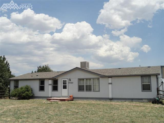17320 Wagon Train Loop, Peyton, CO 80831 (#2747462) :: Jason Daniels & Associates at RE/MAX Millennium