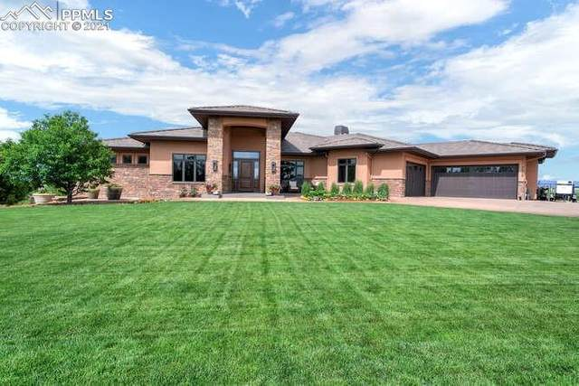 7320 Silver Ponds Heights, Colorado Springs, CO 80908 (#2837247) :: Action Team Realty