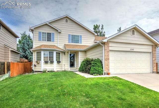 5742 Vermillion Bluffs Drive, Colorado Springs, CO 80923 (#3151418) :: Fisk Team, RE/MAX Properties, Inc.