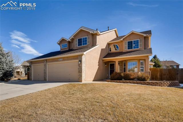 6575 Annanhill Place, Colorado Springs, CO 80922 (#3176685) :: The Hunstiger Team