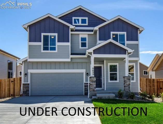 6936 Shunka Lane, Colorado Springs, CO 80925 (#3656339) :: Tommy Daly Home Team