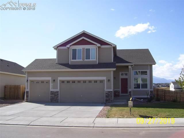 7404 Peachleaf Drive, Colorado Springs, CO 80925 (#3954687) :: The Treasure Davis Team