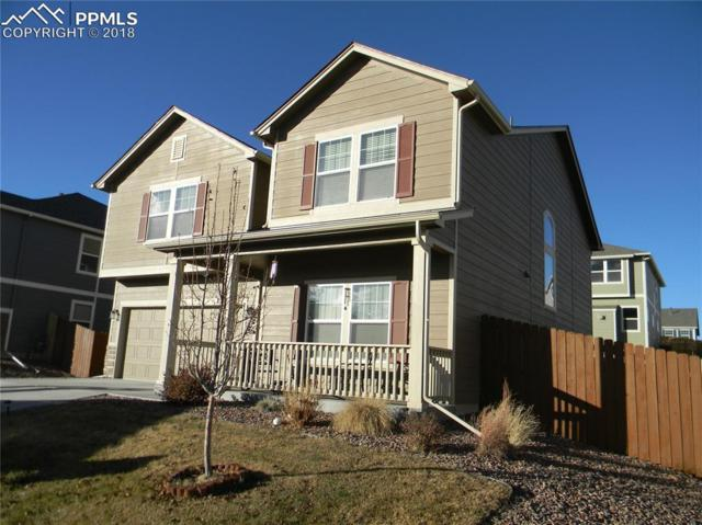 7228 Cat Tail Creek Drive, Colorado Springs, CO 80923 (#4838255) :: The Hunstiger Team