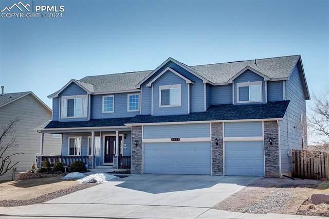 9411 Bur Oak Lane, Colorado Springs, CO 80925 (#5323262) :: The Gold Medal Team with RE/MAX Properties, Inc