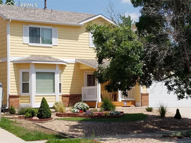 7960 Telegraph Drive, Colorado Springs, CO 80920 (#5559803) :: The Kibler Group