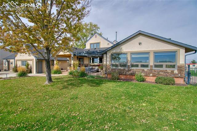 26518 County Road 49, Greeley, CO 80631 (#5932139) :: CC Signature Group