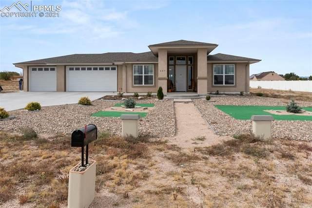 557 S Archdale Drive, Pueblo West, CO 81007 (#5978937) :: Hudson Stonegate Team