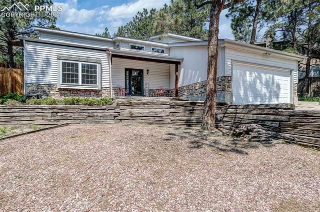 5970 Castlewood Lane, Colorado Springs, CO 80918 (#6121365) :: Fisk Team, eXp Realty