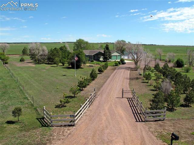 9140 Oto Circle, Colorado Springs, CO 80908 (#6377995) :: HomeSmart