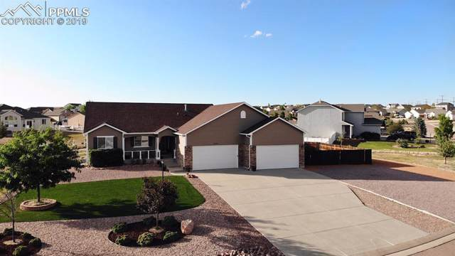 9373 Rockingham Drive, Peyton, CO 80831 (#6498317) :: Action Team Realty