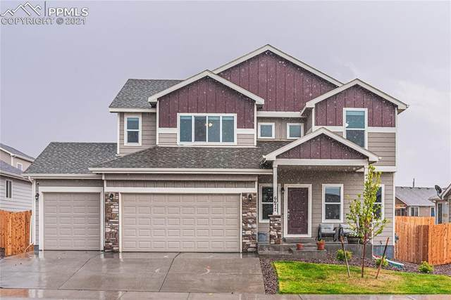 6677 Lamine Drive, Colorado Springs, CO 80925 (#7006414) :: The Kibler Group