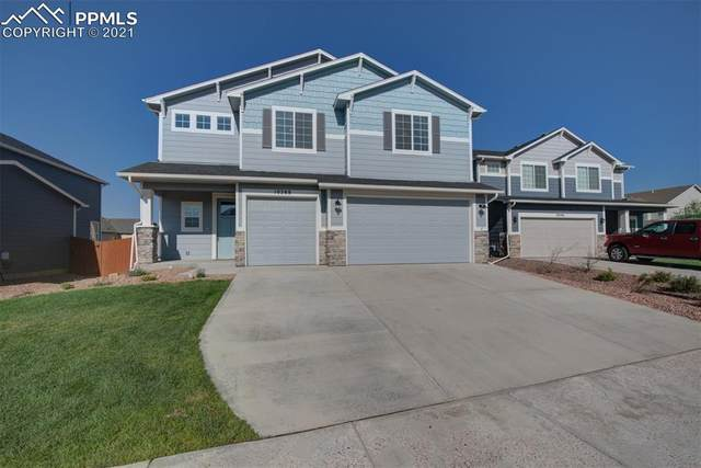 10288 Hidden Park Way, Peyton, CO 80831 (#7117122) :: Tommy Daly Home Team