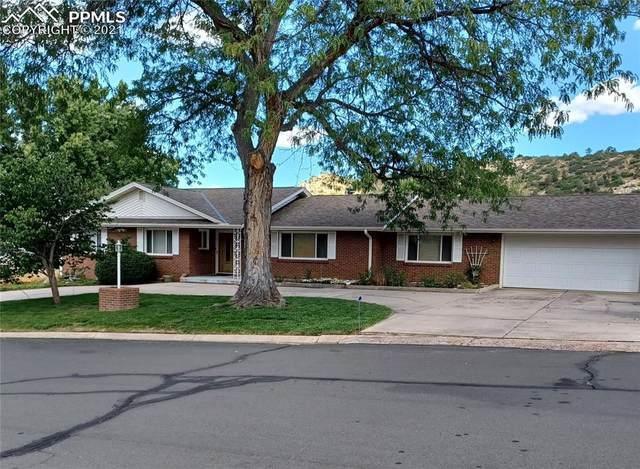 3015 Chelton Drive, Colorado Springs, CO 80909 (#7459591) :: Symbio Denver