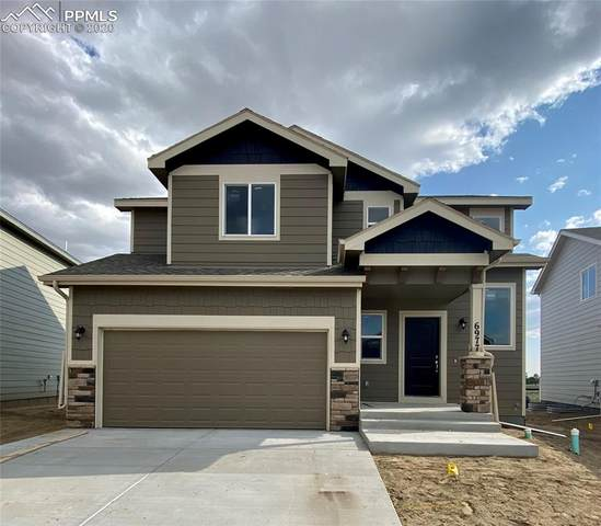 6977 Winnicut Drive, Colorado Springs, CO 80925 (#8045445) :: Action Team Realty