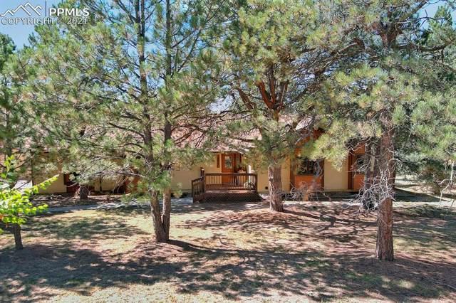 14990 E Coachman Drive, Colorado Springs, CO 80908 (#8055397) :: The Daniels Team