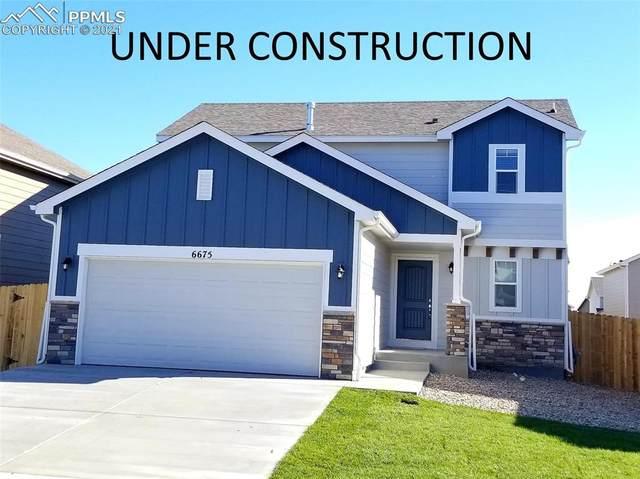 6922 Shunka Lane, Colorado Springs, CO 80925 (#9172558) :: Tommy Daly Home Team