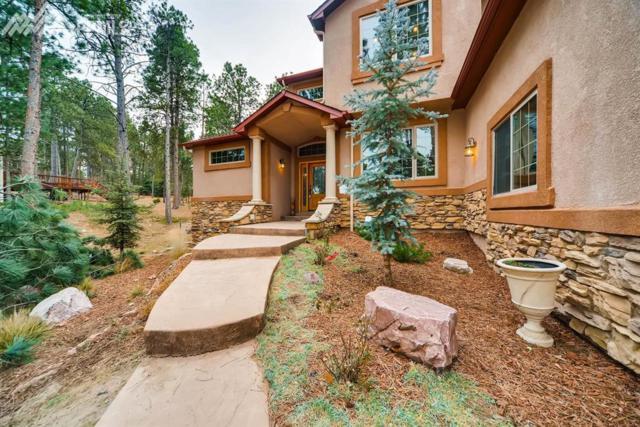 17766 Sawmill Road, Colorado Springs, CO 80908 (#9513097) :: The Hunstiger Team